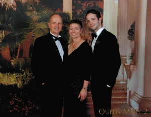 A family portrait aboard Cunard's Queen Mary 2 last summer.  It's the only way for the three of us to get a professional portrait since we live on a different continent than our son.  A great opportunity when we're all dressed up.
