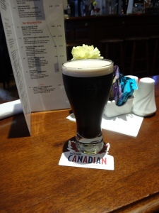 Guinness: An Irish tradition served on a Canadian beer coaster!